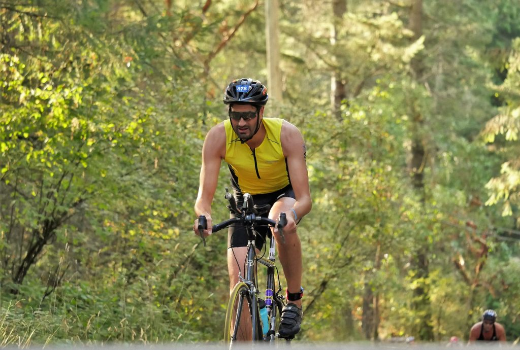 Travis riding in a triathlon