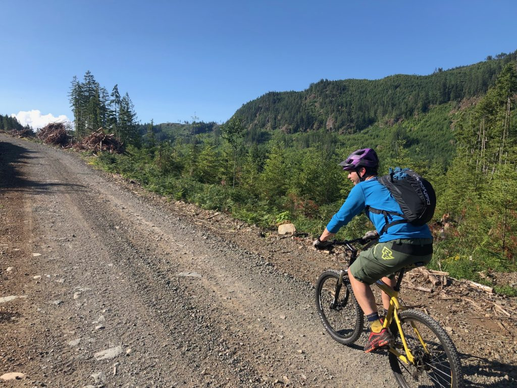 Rob Scott on the incline of a gravel road on the way to the summit above the Alberni Valley